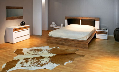 cowhide rug in bedroom